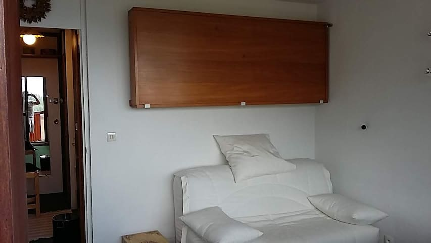Sofa easily converted to double bed. Above single fold down bed