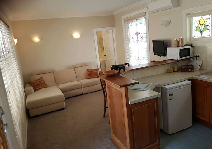 View of lounge and kitchenette with door into double bedroom