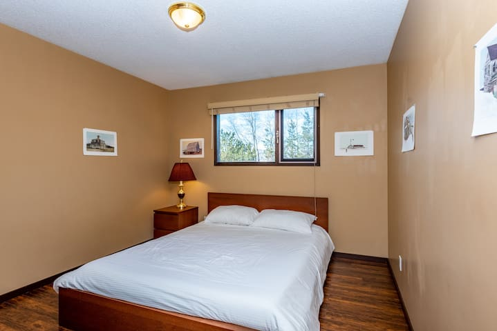 West end bedroom, with a queen bed.
