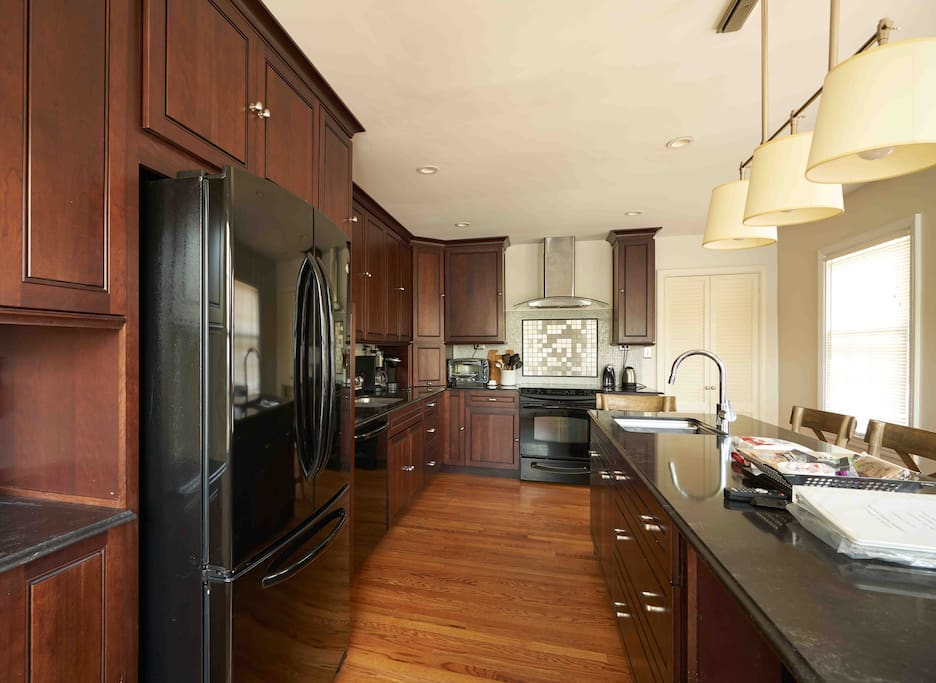 Bright and Airy Newly remodeled custom designed kitchen.  Seats 6 at island.