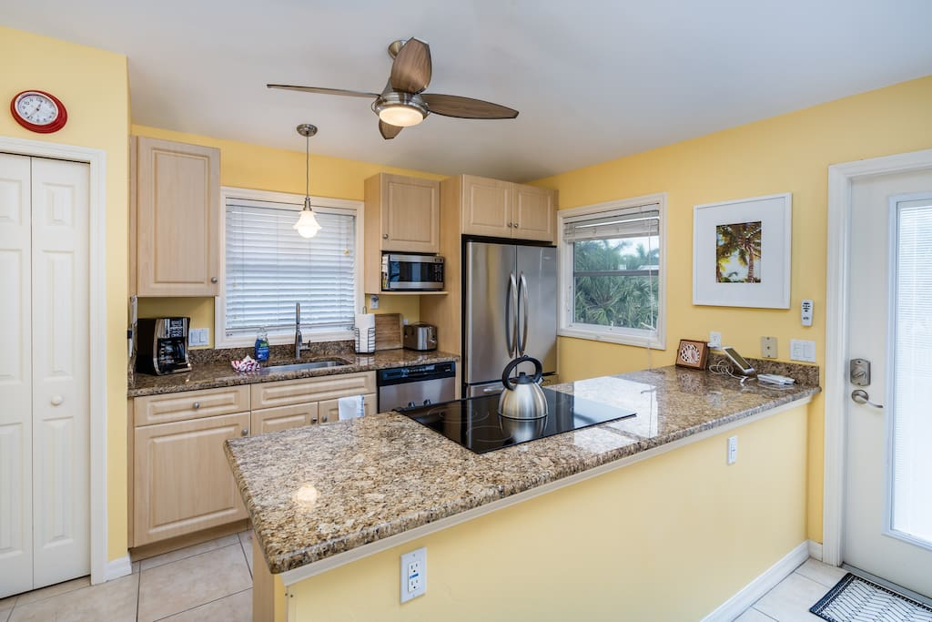 The kitchen with granite countertops and a full suite of modern appliances