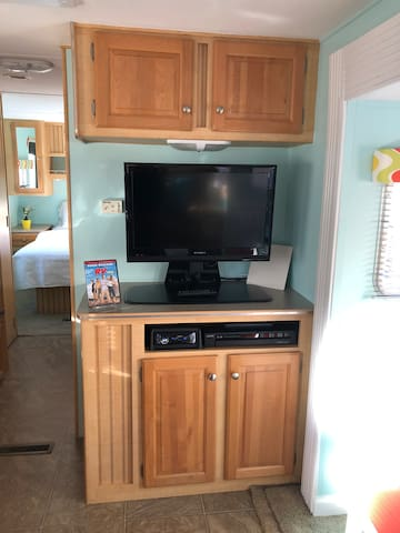 TV with DVD player.  Stereo with CD player.