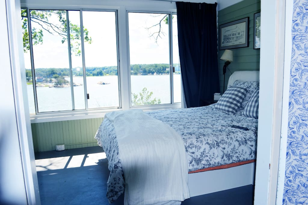 Master bedroom has two glass walls with an incredible view.