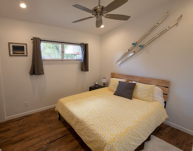 2nd bedroom with Queen bed.  New lighting and Ceiling fan. Bright natural lighting with blackout curtains.