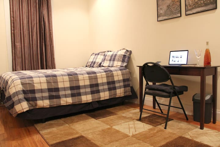 Queen bed. Desk and chair.