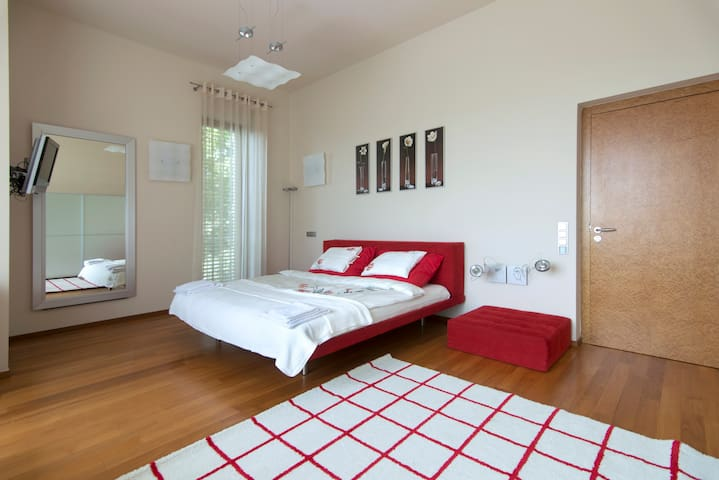 Master bedroom with large - king size bed, very comfortable, italian designed, 2nd floor