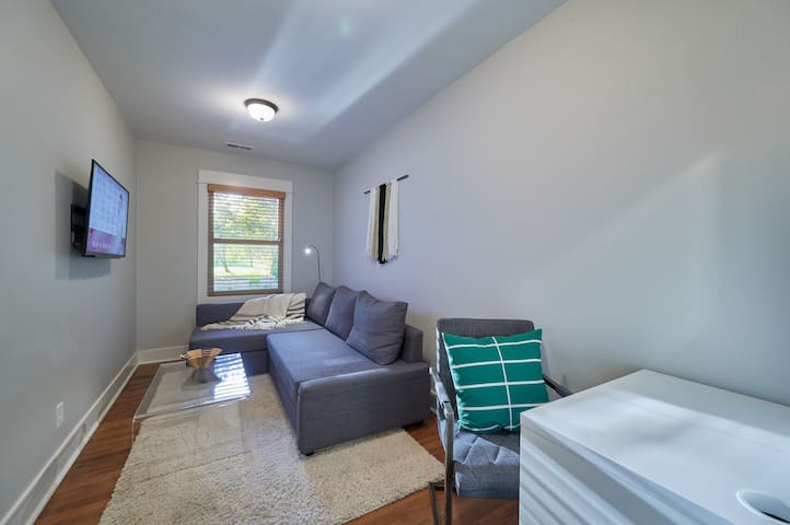 Third bedroom/office with smart TV and queen-sized fold-out bed.