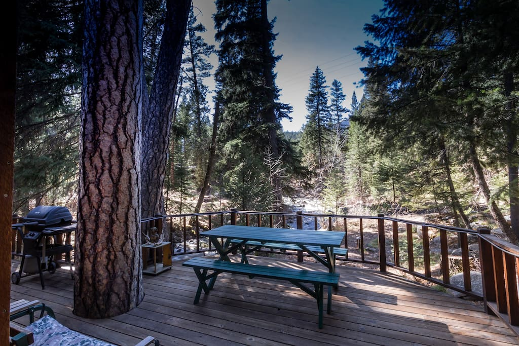 Deck looks over Boulder Creek and Bitterroot forest