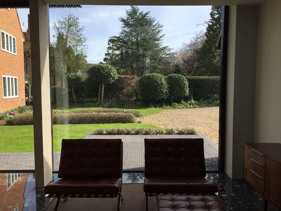 Sliding wall window onto terrace & shared front garden