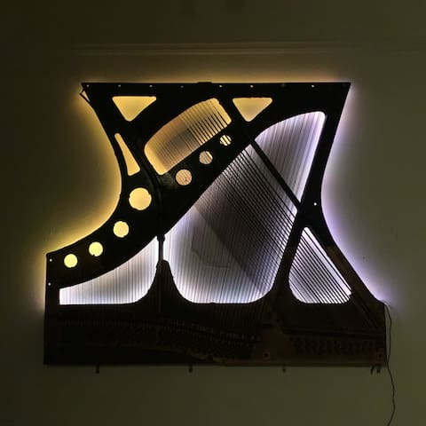 I made this backlit wall art from the inside of a piano