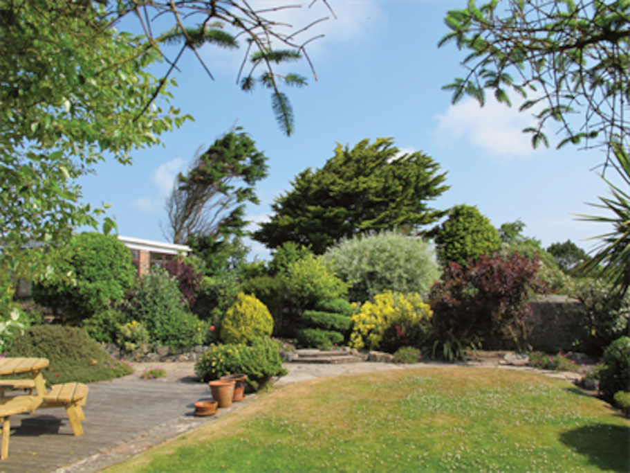 Our gardens have a summerhouse, large sunny decking and lawns