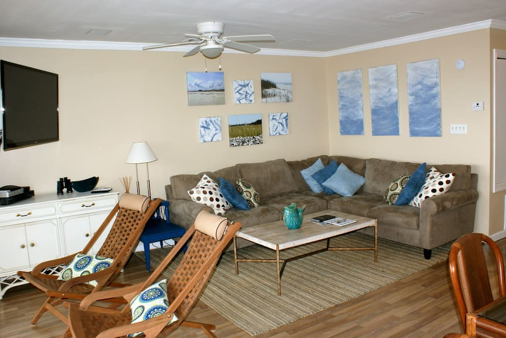 The living room looks right out to the beach