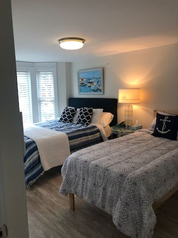 Extra long twin bed and queen bed in second bedroom