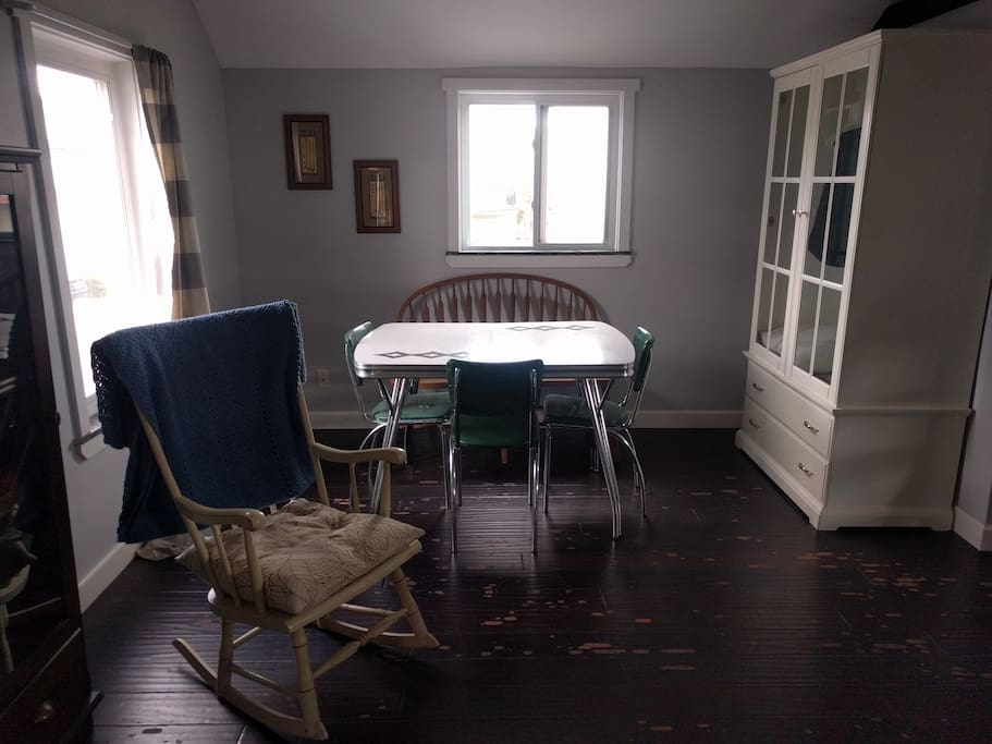 Dining Table, rocking chair and clothing armoire