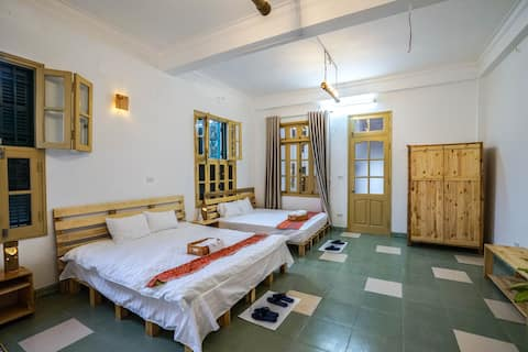 Bed room with two king-size bed, suitable with a family or group of 3-4 people.