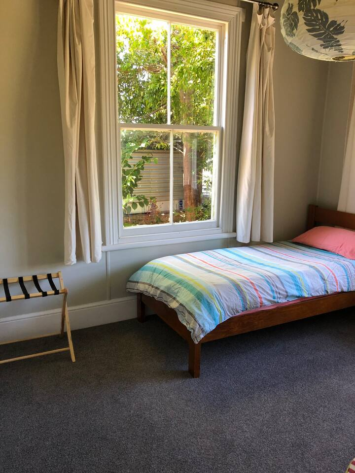 Room in share house very close to town and stream