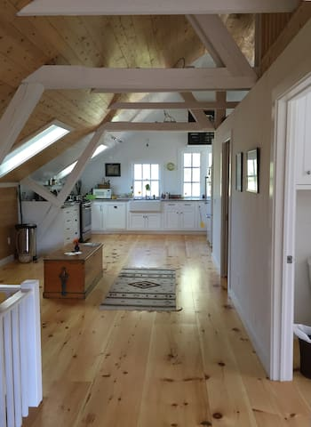 The loft consists of one open-air room with two bedrooms and bath built into the right side