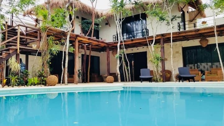 Departamento entero balcón vista a jardín tropical