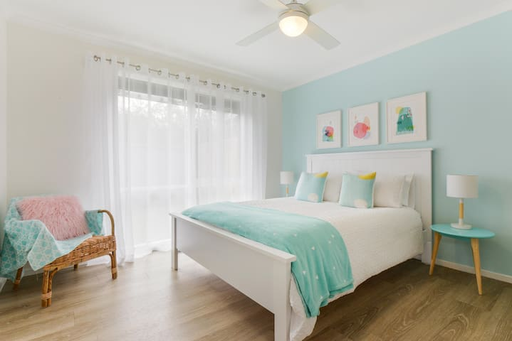 Light filled bedroom 2 with comfy queen size bed