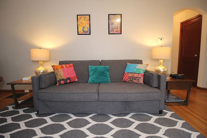 The sleeper sofa in the living room sleeps 1-2 people.  Pillows and sheets are stored under the bottom cushions.  Heavier blankets are in the hall closet.