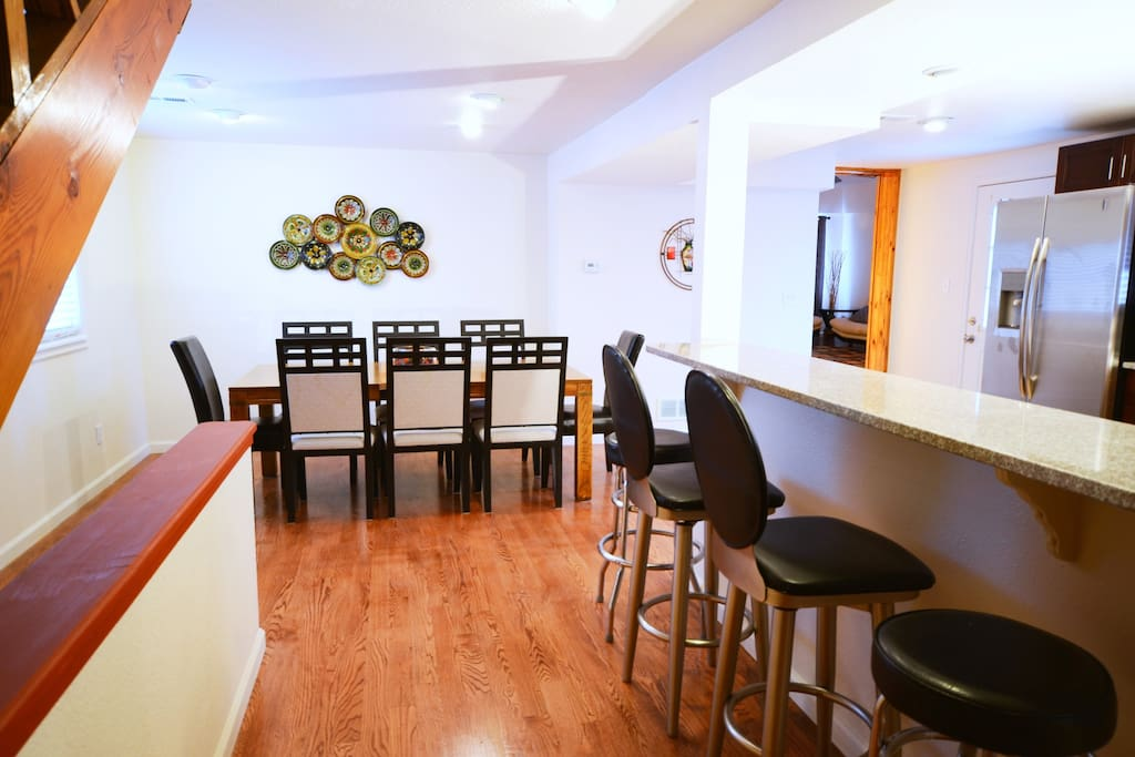 Dining table fits 6 and bar area accommodates 4.
