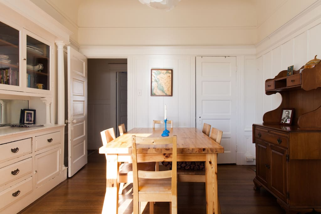 The sunny dining room seats six to eight and has a built-in hutch and view of hills.
