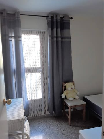 Single bedroom with access to terrace