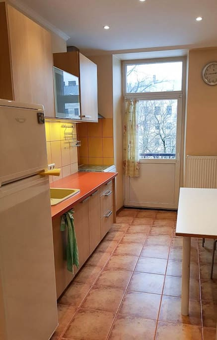 Kitchen with balcony and view on courtyard and little bit on Daugava