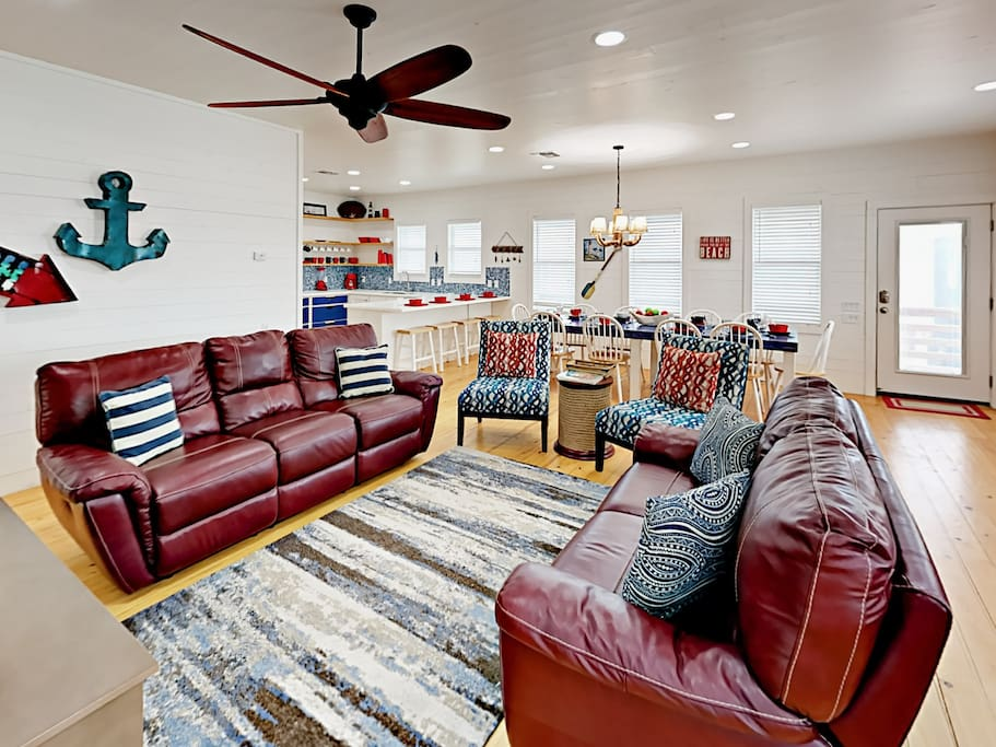 Rich hardwood floors, upscale furnishings, and coastal-chic decor are sure to please in this rental.