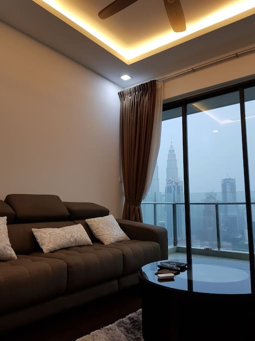 living room facing klcc and kl tower view