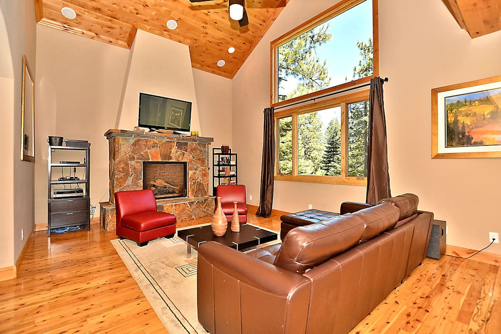 With vaulted ceilings and huge window overlooking the wooded lot.