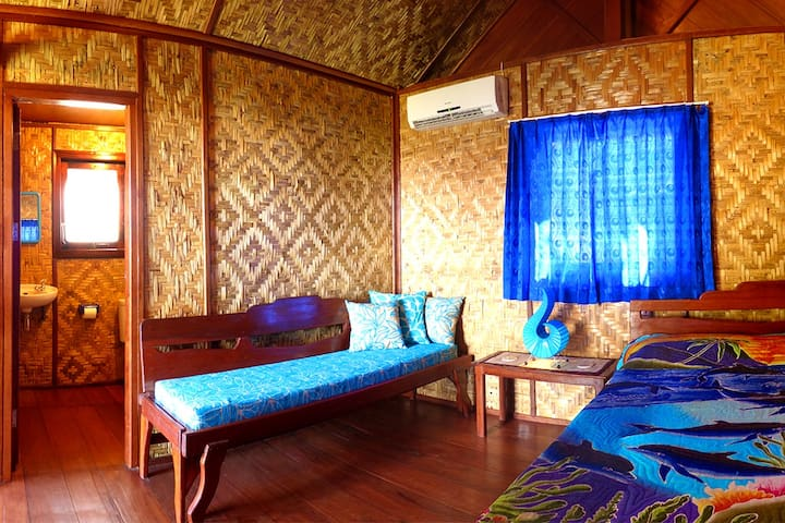 """The sea view bungalow has air-con and an en-suite bathroom. This """"double"""" room has a sofa instead of a single bed. Great for couples!"""