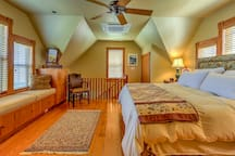 The master bedroom boasts a plush king-sized bed and reading nook.