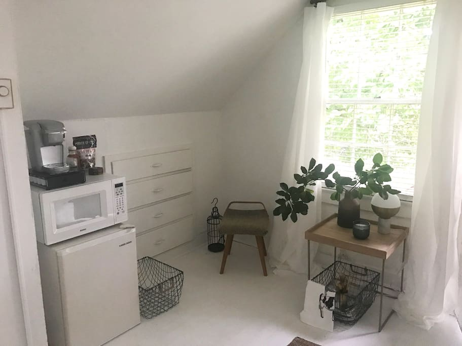 Breakfast area with Keurig, refrigerator, and microwave.
