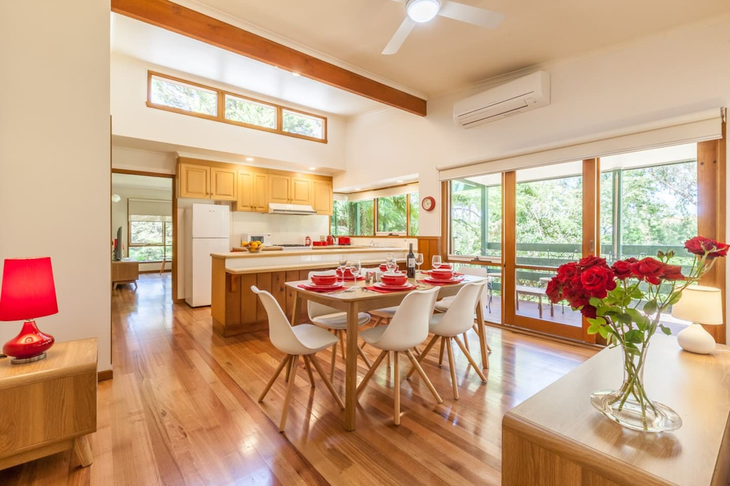 The spacious kitchen/dining area has a high ceiling and big windows making it light and bright.