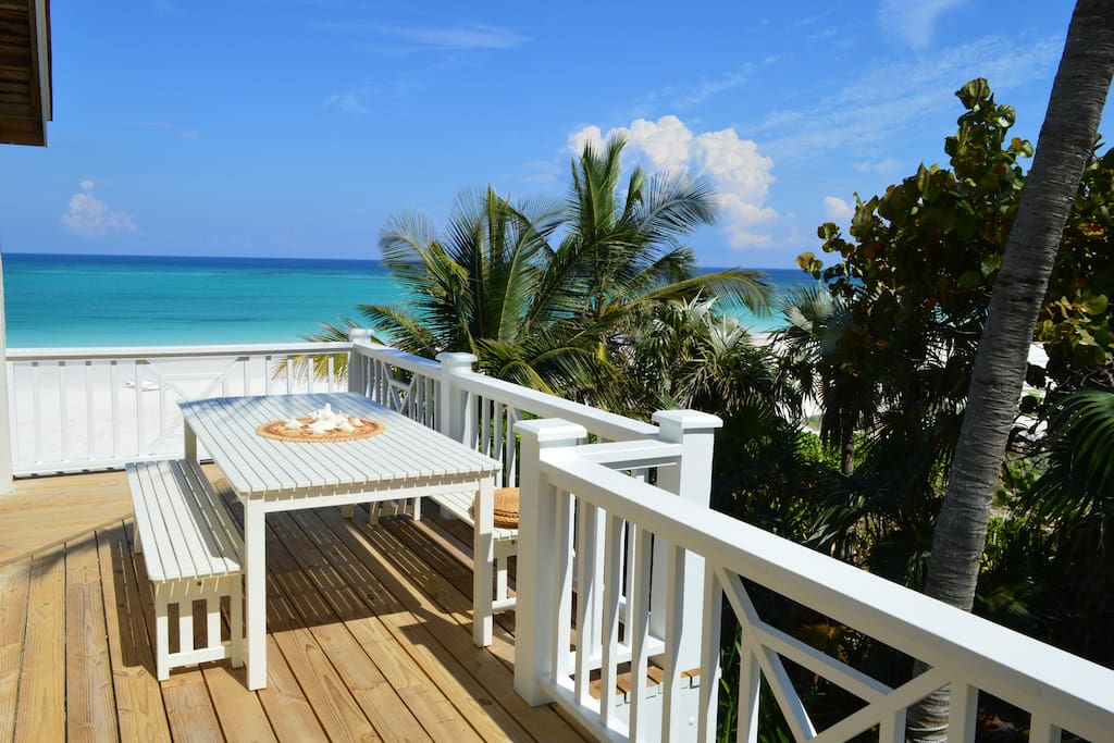 View to the beach from the outdoor dining area on the new wrap-around deck.