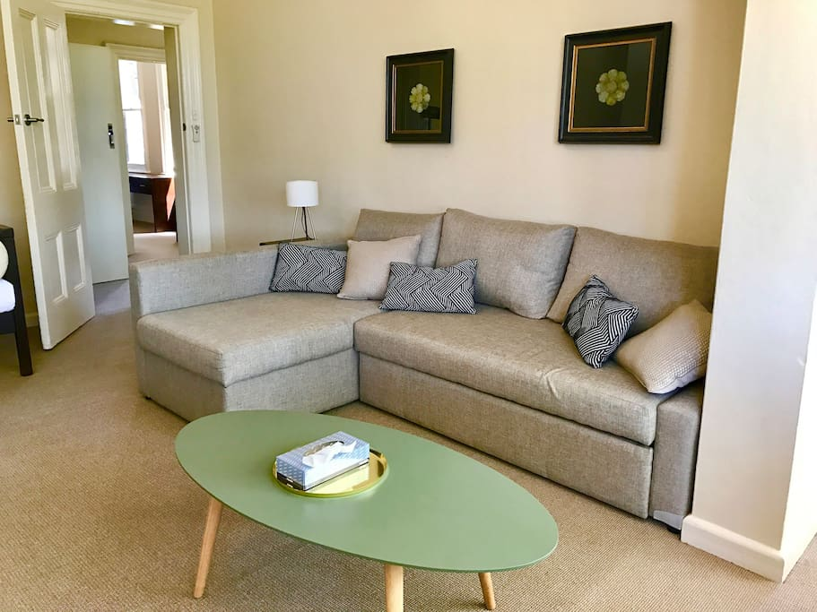The lounge room has  a large sofa which is also a pull out queen bed.