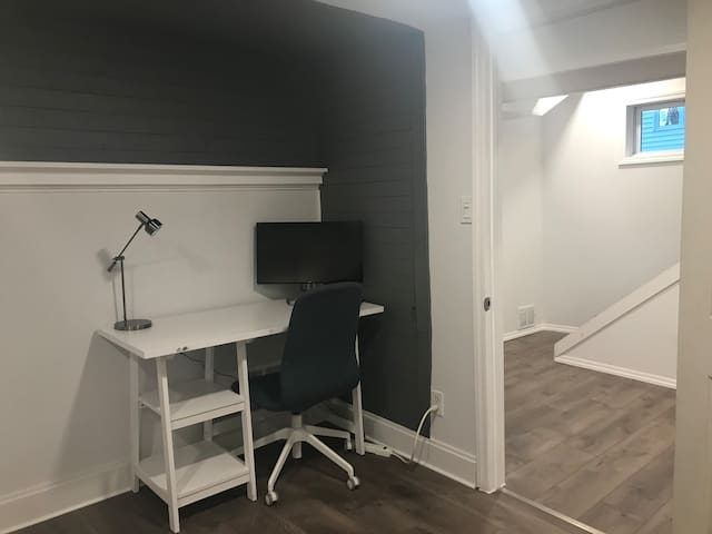 Working space in bedroom with external monitor.