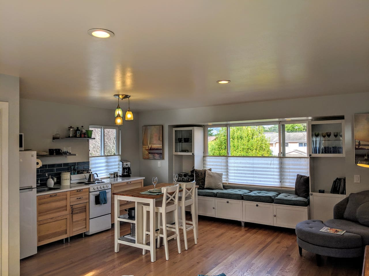 A bright open space with full kitchen, cozy seating, and all the amenities you could ask for awaits.