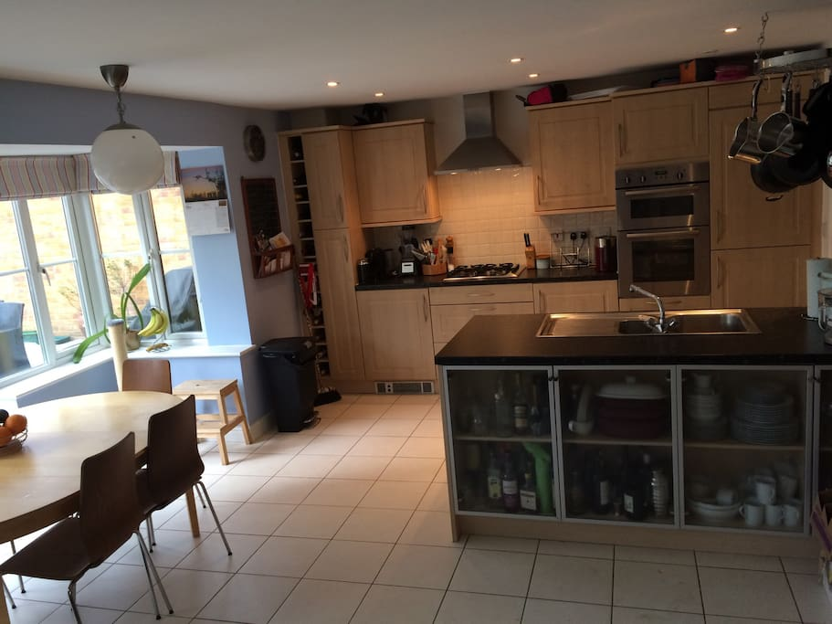 Spacious modern kitchen with seating for 8- access directly to our beautifully landscaped garden where you can enjoy a cold beer on arrival. Help yourself to tea and coffee with the Nespresso machine.