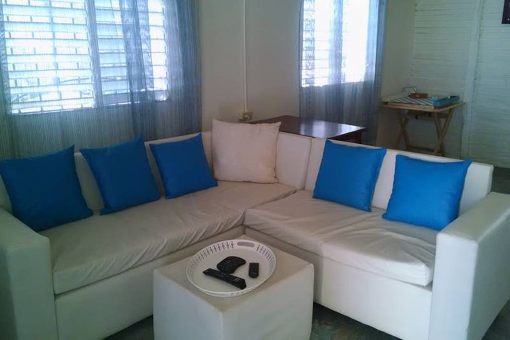 Common area sofa which converts to a bed.