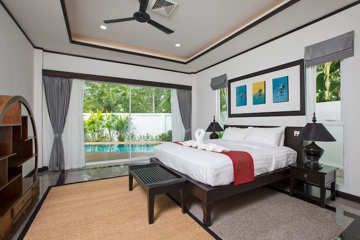 Bedroom #2 with pool access and ensuite bathroom. All the bedrooms have king size beds with luxury mattresses and bed linens