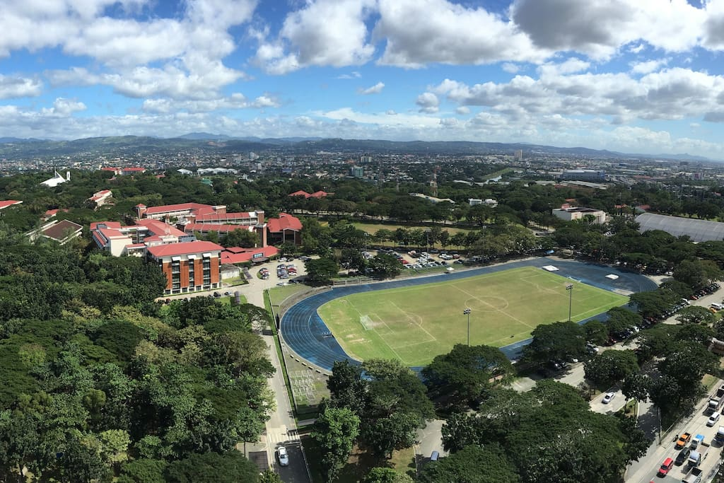 Enjoy the view of the beautiful Ateneo de Manila campus and the Sierra Madre mountains.