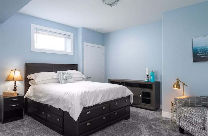 The main bedroom boasts a queen bed with plenty of drawer storage under the bed.