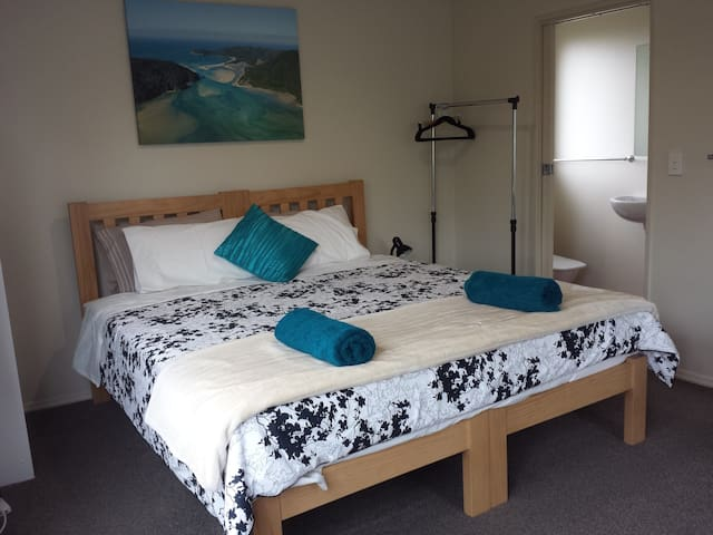 Superking size bed or twin single beds.