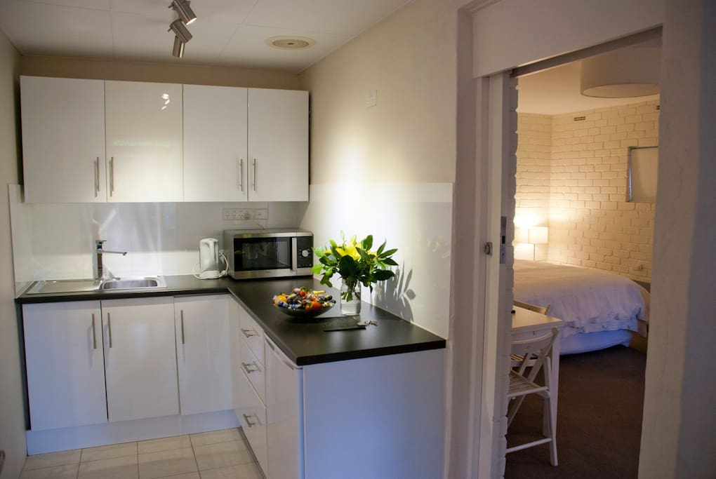 Kitchenette with microwave, toaster, kettle and electric frypan