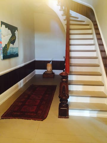 Grand Walnut with mother of pearl inlay staircase