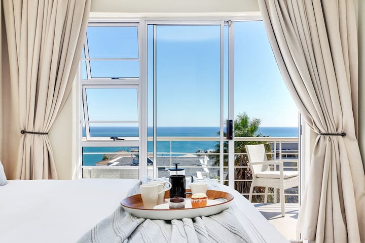 Master bedroom leads onto the balcony offering breathtaking views of the ocean.