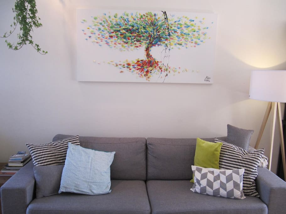 Comfortable couch and a painting from Israel