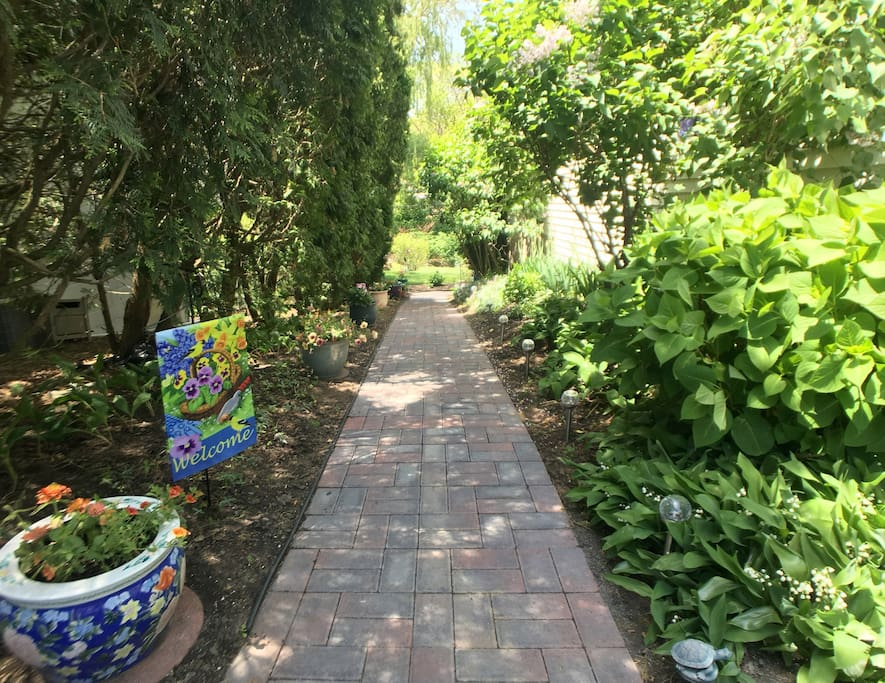 The newly laid garden pathway leads you from the included off-street parking to your patio and private entrance.